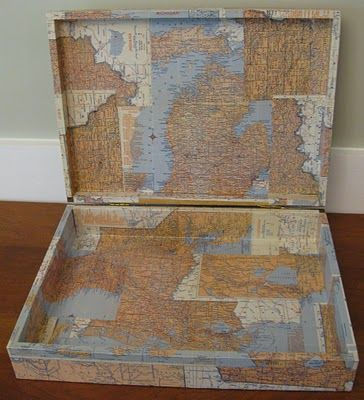 DIY map box for storage - love the idea of using a map to resurface the inside of an old trunk