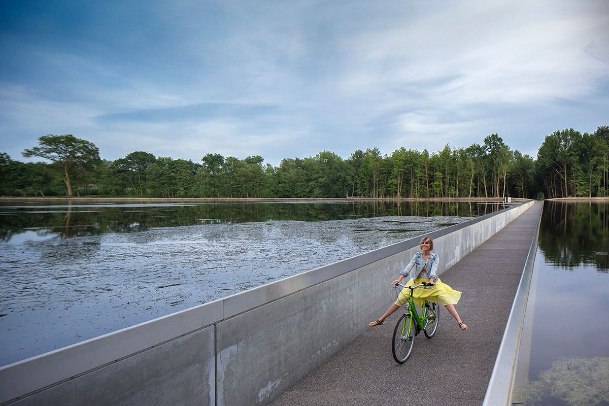 Cycling Through Water Bicycle Travel Belgium Travel Pond