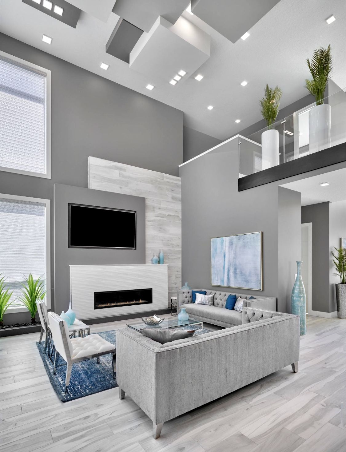 It's likely you and your guests will spend countless hours in this room, discussing and entertaining. Grey and white modern living room decor with grey velvet ...