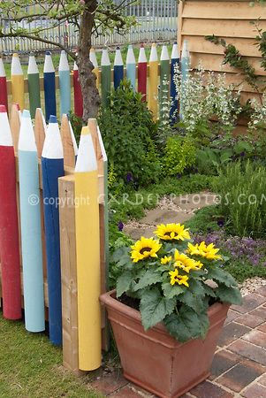 Learning at home Crayon picket fence, pot of sunflowers Outdoor