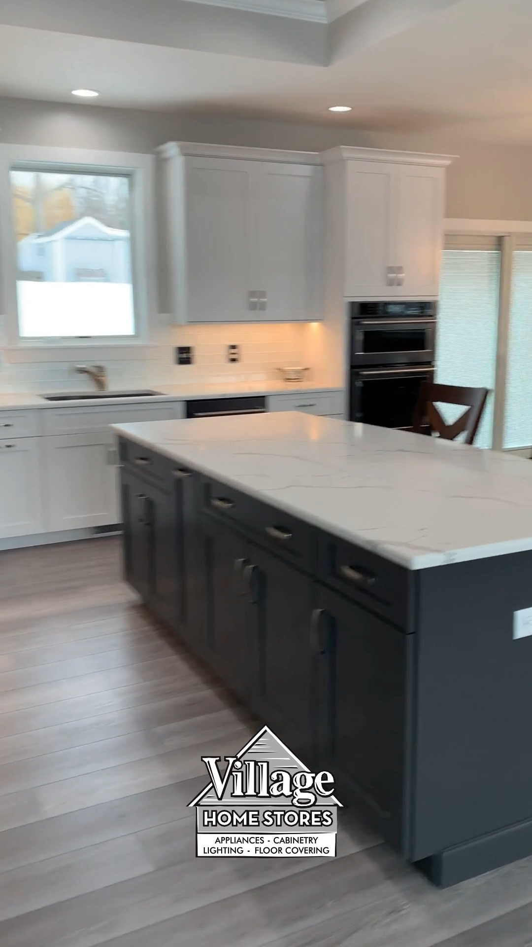 White and Pewter Painted Kitchen With Black Stainless Appliances