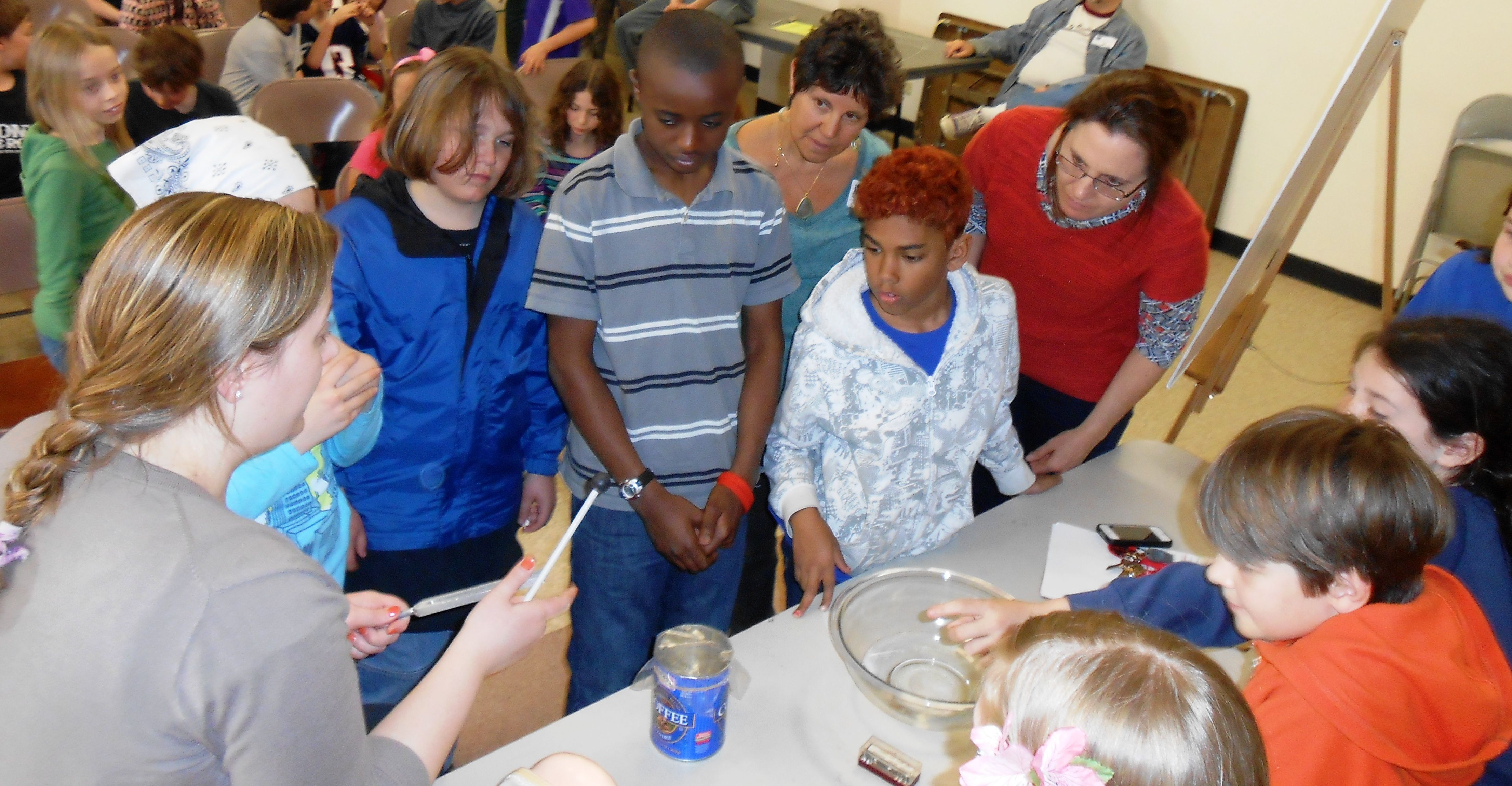 Students experiment with pitch and resonance during a Light & Sound field trip program.
