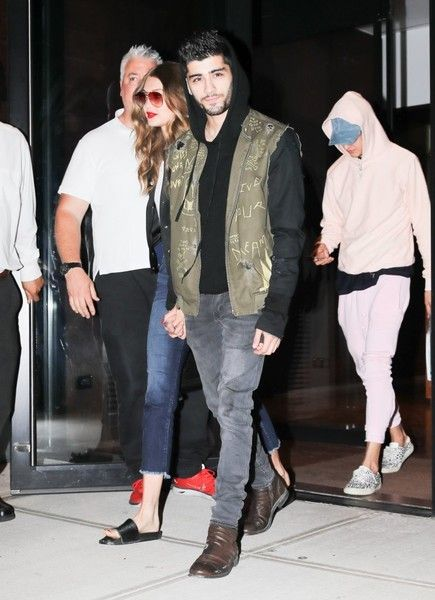 Model Gigi Hadid and Zayn Malik were spotted out and about in New York City, New York on July 14, 2016.  The two held hands with one another while they came out into the bright flashy crowd.