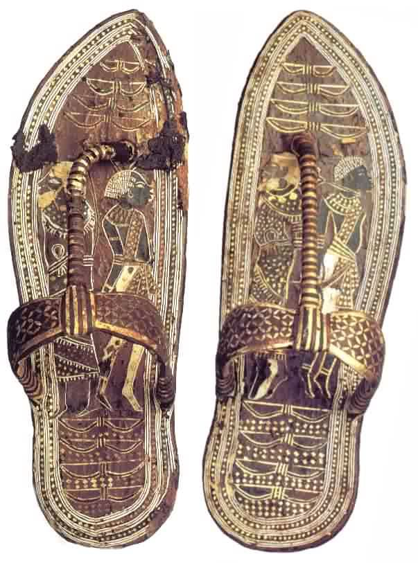 Tutankhamen's sandals. Wood sandals with gold foil on stucco base, overlaid with marquetry veneer of bark and green leather