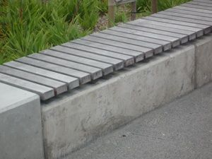Timber Slats Situated Onto A Galvanised Steel Frame On Top Of A Concrete Precast Structu Outdoor Gardens Design Concrete Bench Outdoor Concrete Retaining Walls