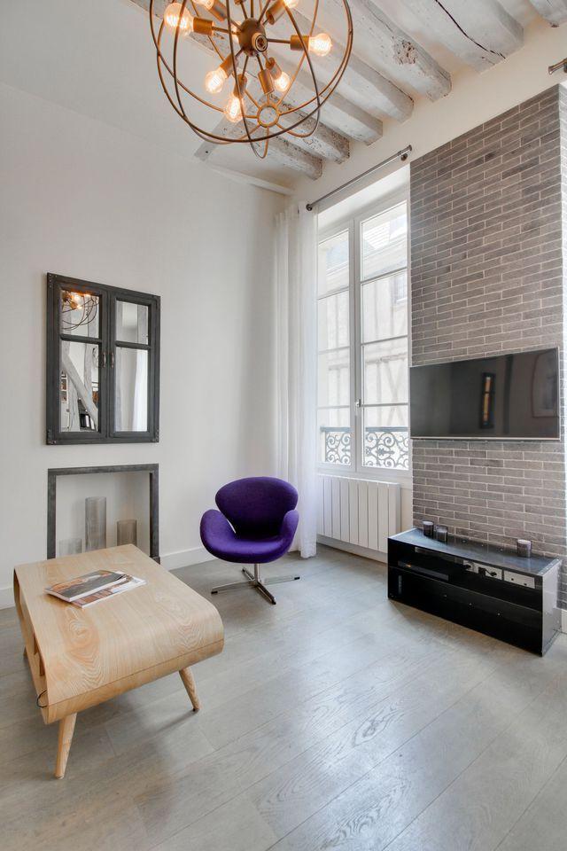 Appartement Paris Marais  un esprit du0027atelier avec poutres - deco maison avec poutre