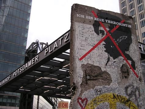 Piece of the Berlin Wall at Potsdamer Platz square (once part of East Germany and today a busy area of modern architecture and international businesses)