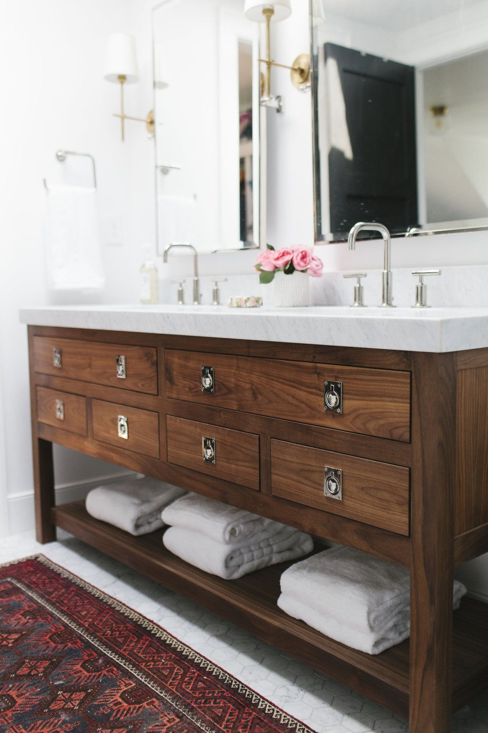Bathroom vanity with drawers and an open shelf