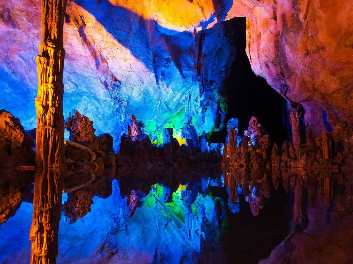 Explore the illuminated stalagmites and stalactites of the Reed Flute Cave in Guilin. 38 places you need to visit in China | Business Insider