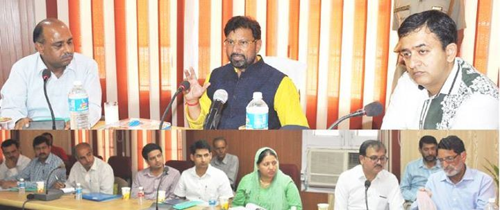 Forest Minister Ch Lal Singh chairing meeting of officers on Tuesday.