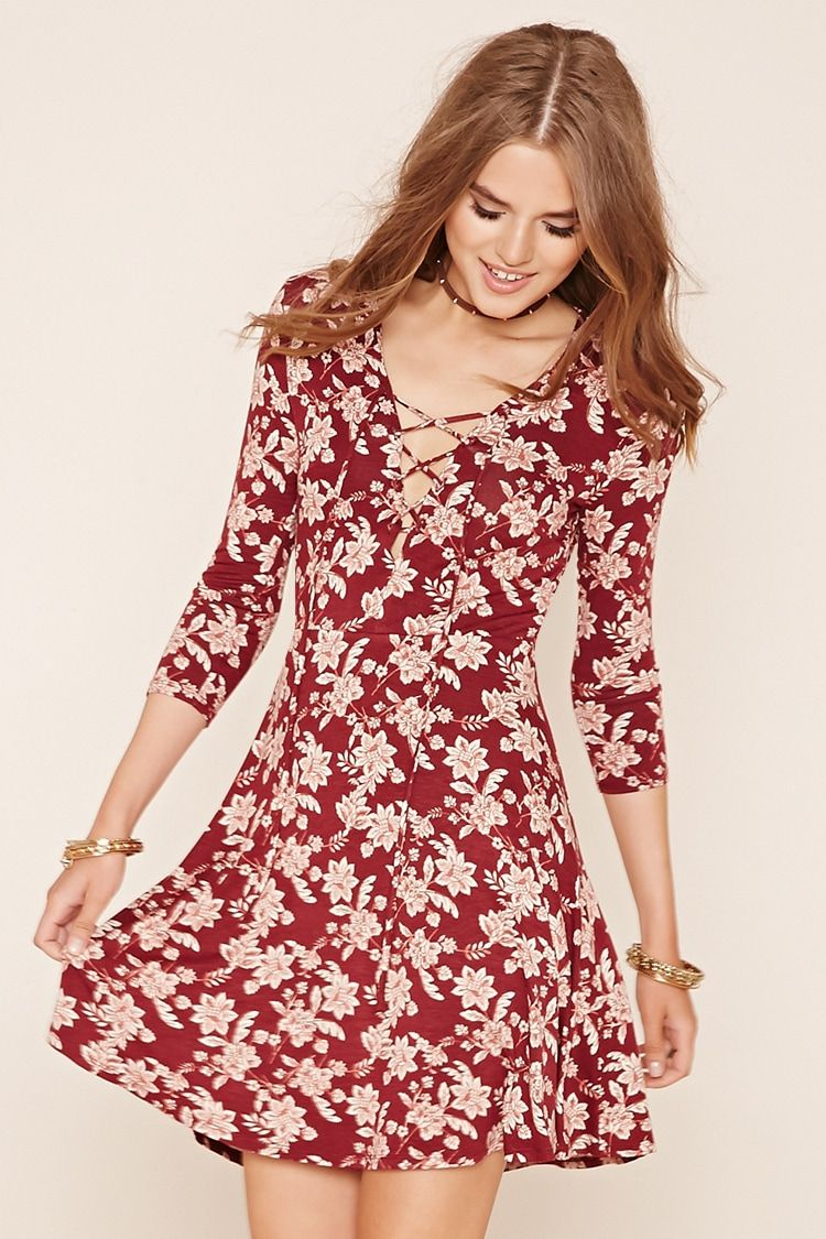 A knit skater dress with an allover floral print, 3/4 sleeves, and a ...