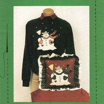 Let It Snow! Applique for Sweatshirts, Pillows, Crafts by Appli-Kays, an easy snowman applique pattern.   Materials Needed:  For Snowman: Fabric Scraps--unbleached muslin for snowman, your color choices for carrot, nose, hat, scarf, mittens, 3 patches, broom, and handle.  Matching thread ...