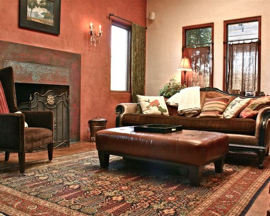Great earth tones and terra cotta wall color that blends everything color wise in with the large for Terracotta living room ideas
