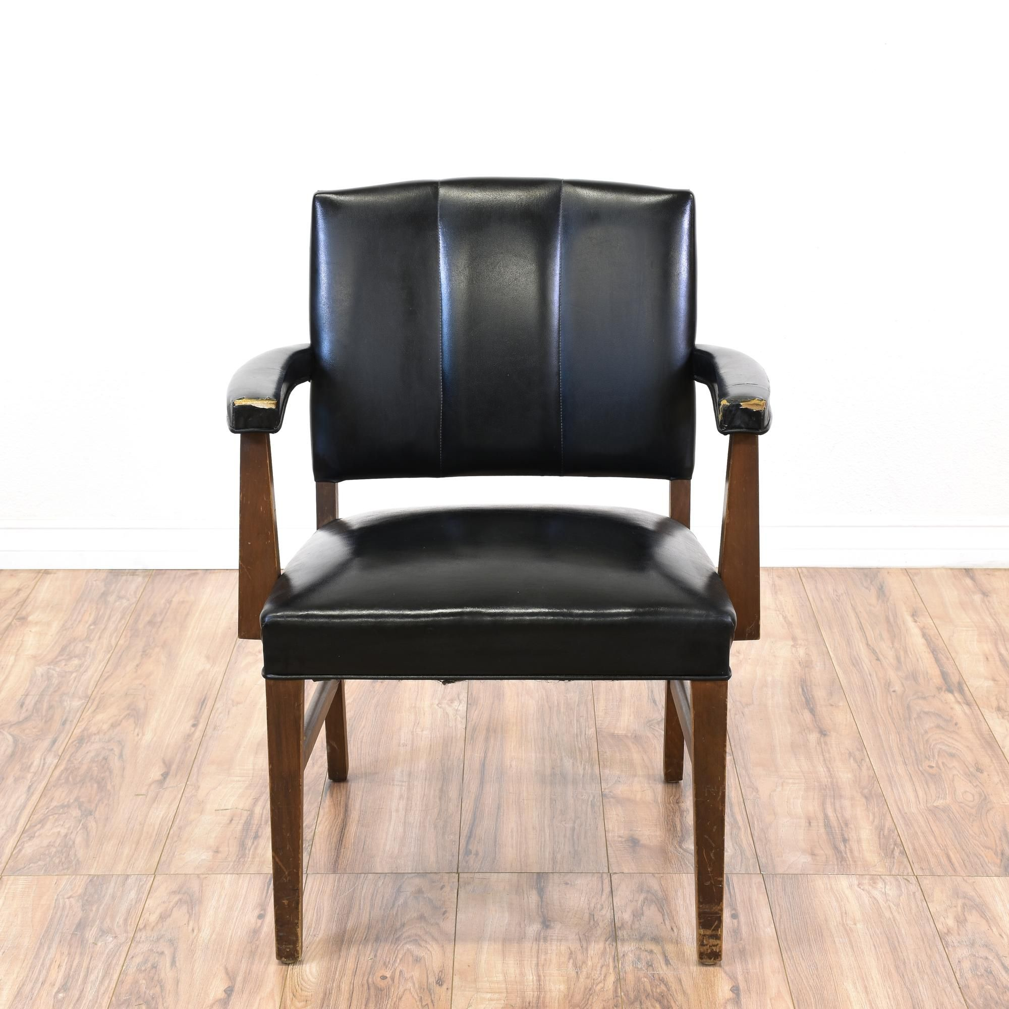 This Mid Century Modern side chair is featured in a solid wood