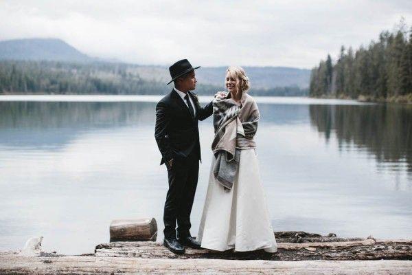 Candid shot of the groom and bride alongside the beautiful lake. | Image by Nicole Mason