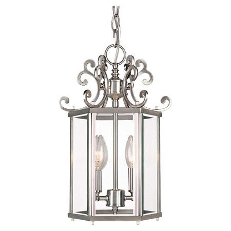 Cast a chic glow over your entryway or kitchen island with this eye-catching pendant, featuring a scrolling top and glass panels.  P...