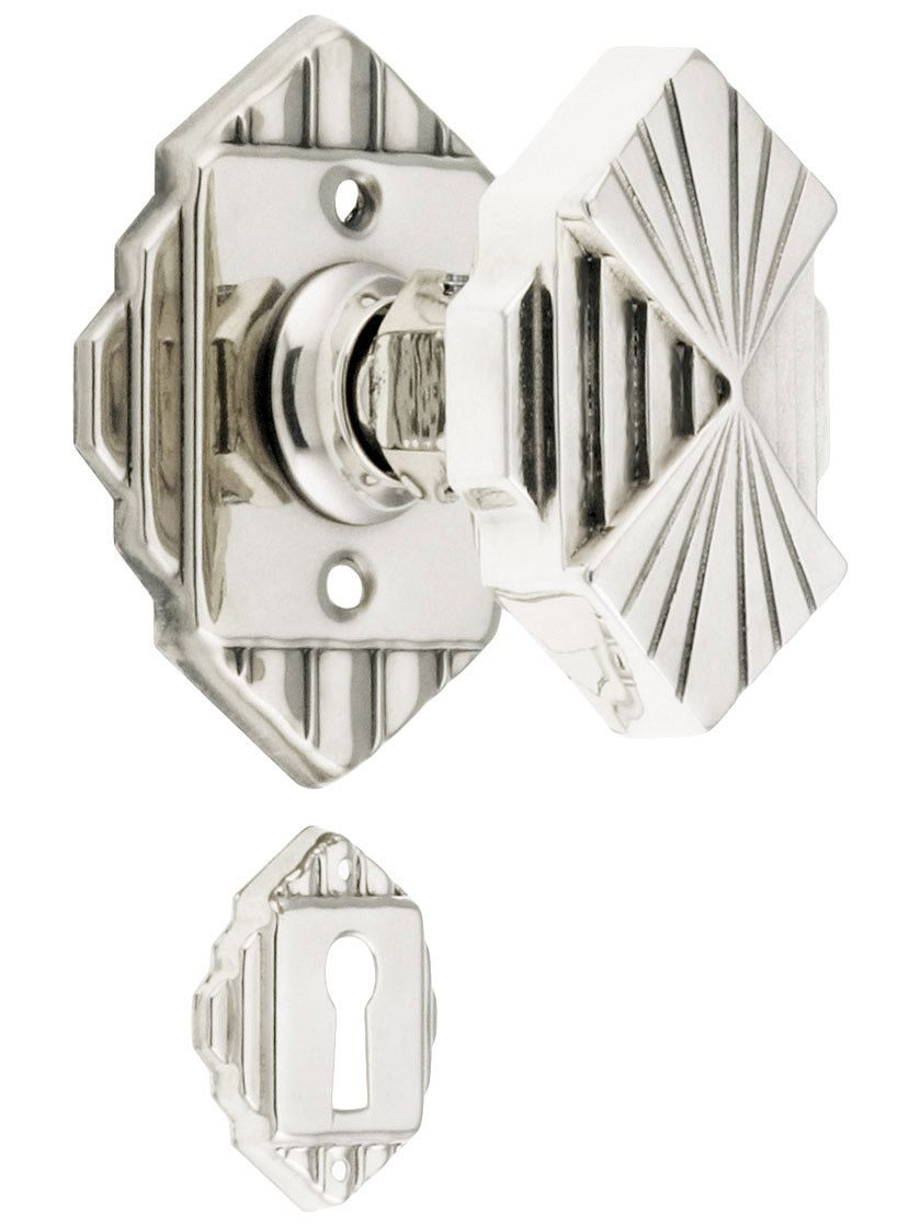 Art deco door knob and plate with accentuated geometric pattern