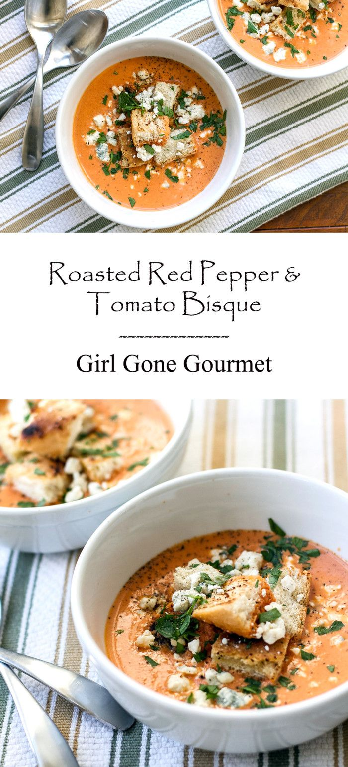 Creamy roasted red pepper & tomato bisque garnished with homemade croutons and blue cheese crumbles - from www.girlgonegourmet.com