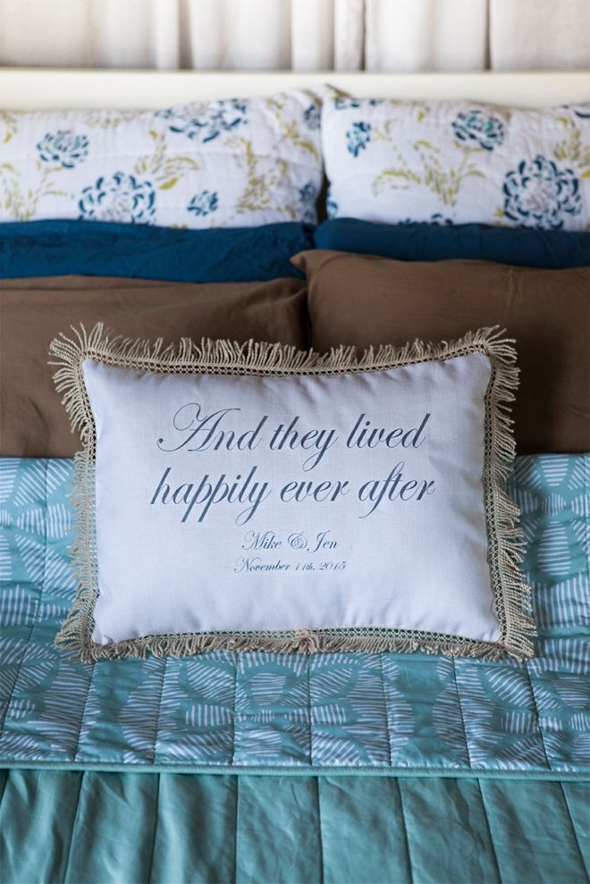 """""""And they lived happily ever after"""" pillow from Things Remembered... could be great for the ring bearer to carry back down the aisle!"""