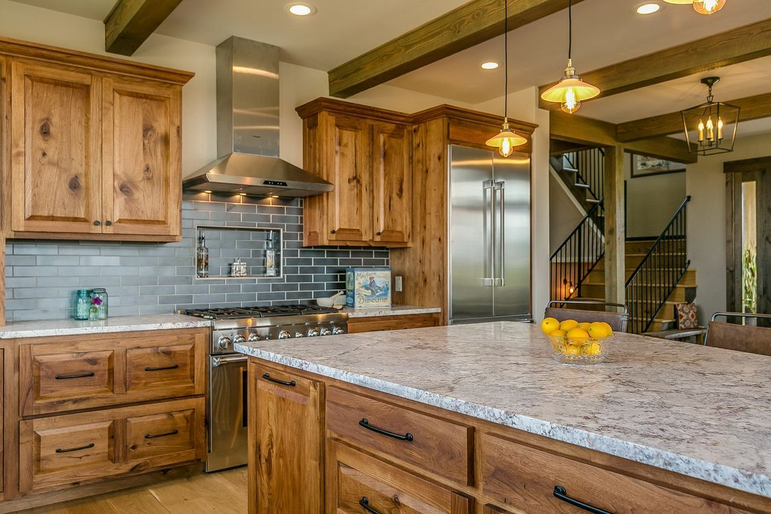 Rustic Kitchen With Exposed Beams Knotty Wood Cabinets And Blue