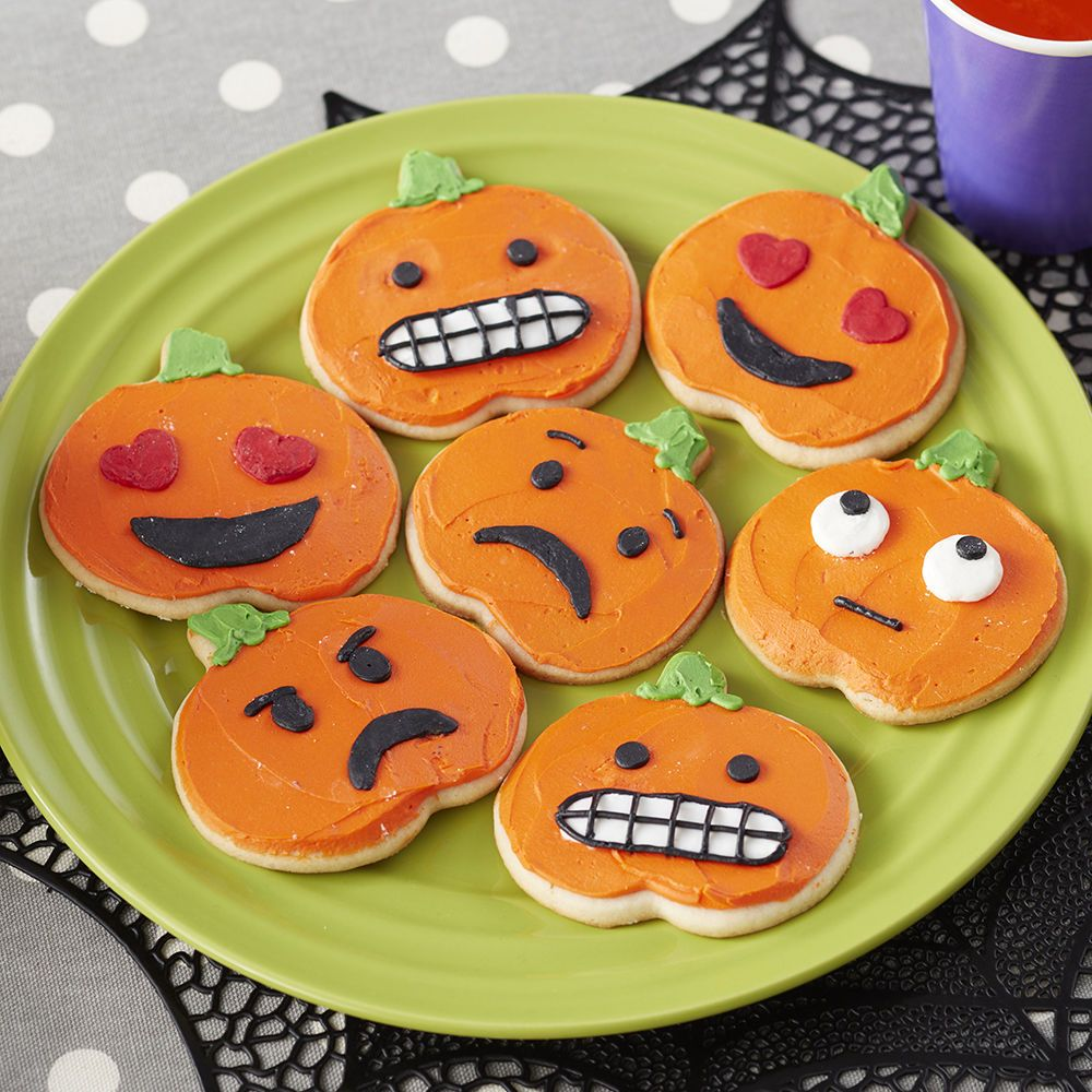 Forget carving pumpkins this year, with these Pumpkin Emoji Cookies - Halloween Decorated Cookies