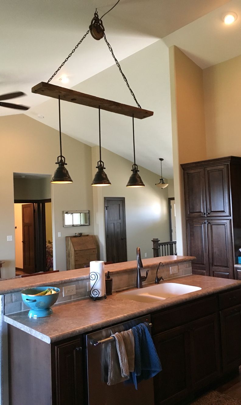 Barn wood pulley vaulted ceiling light fixture pendants are from