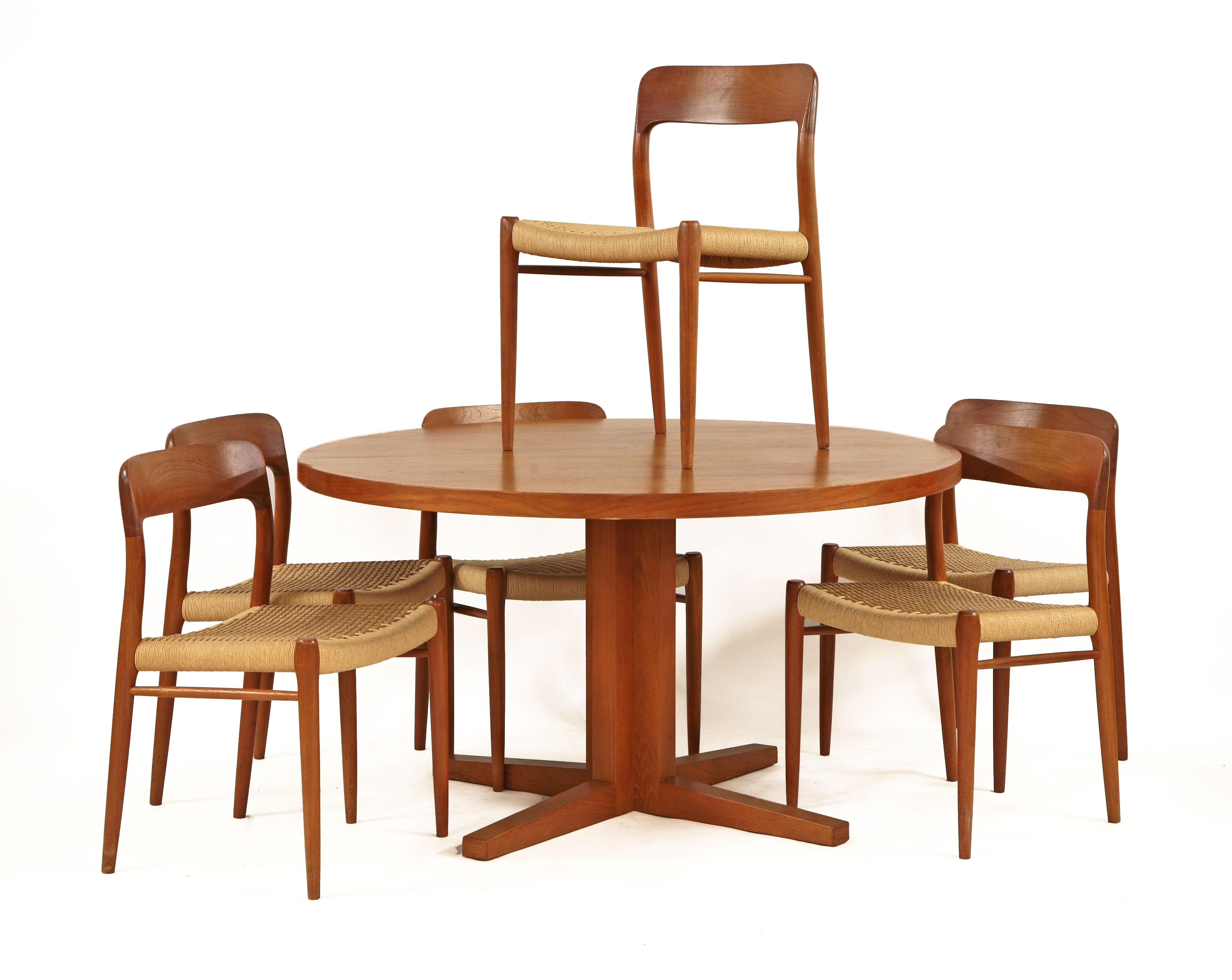 A Set Of Six Teak Model 75 Dining Chairs Designed By Niels O Mller For J L With Woven Cord Seats And Backs Labelled Danish Furniture
