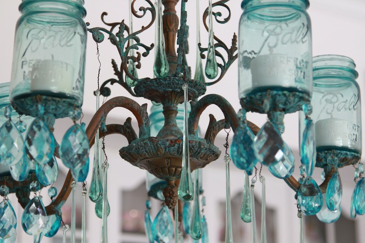 Re purposing a chandelier as a patio candle ier with mason jars re purposing a chandelier as a patio candle ier with mason jars glass arubaitofo Choice Image