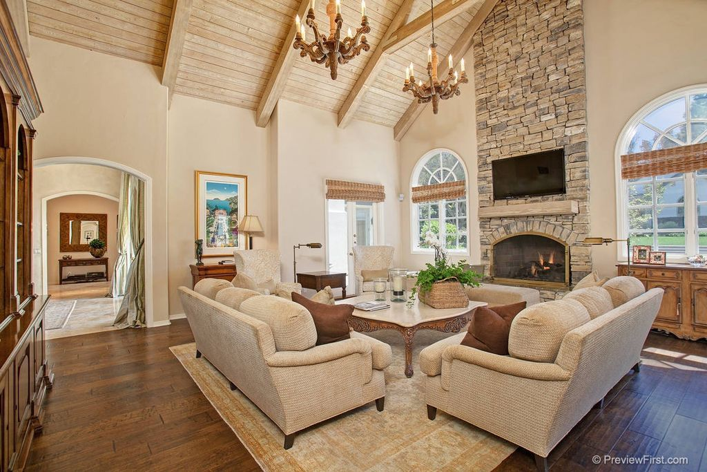 Traditional Living Room With Handscraped Wood Floors Chandelier French Doors Cathedral Ceiling Living Room Vaulted Ceiling Living Room Vaulted Living Rooms