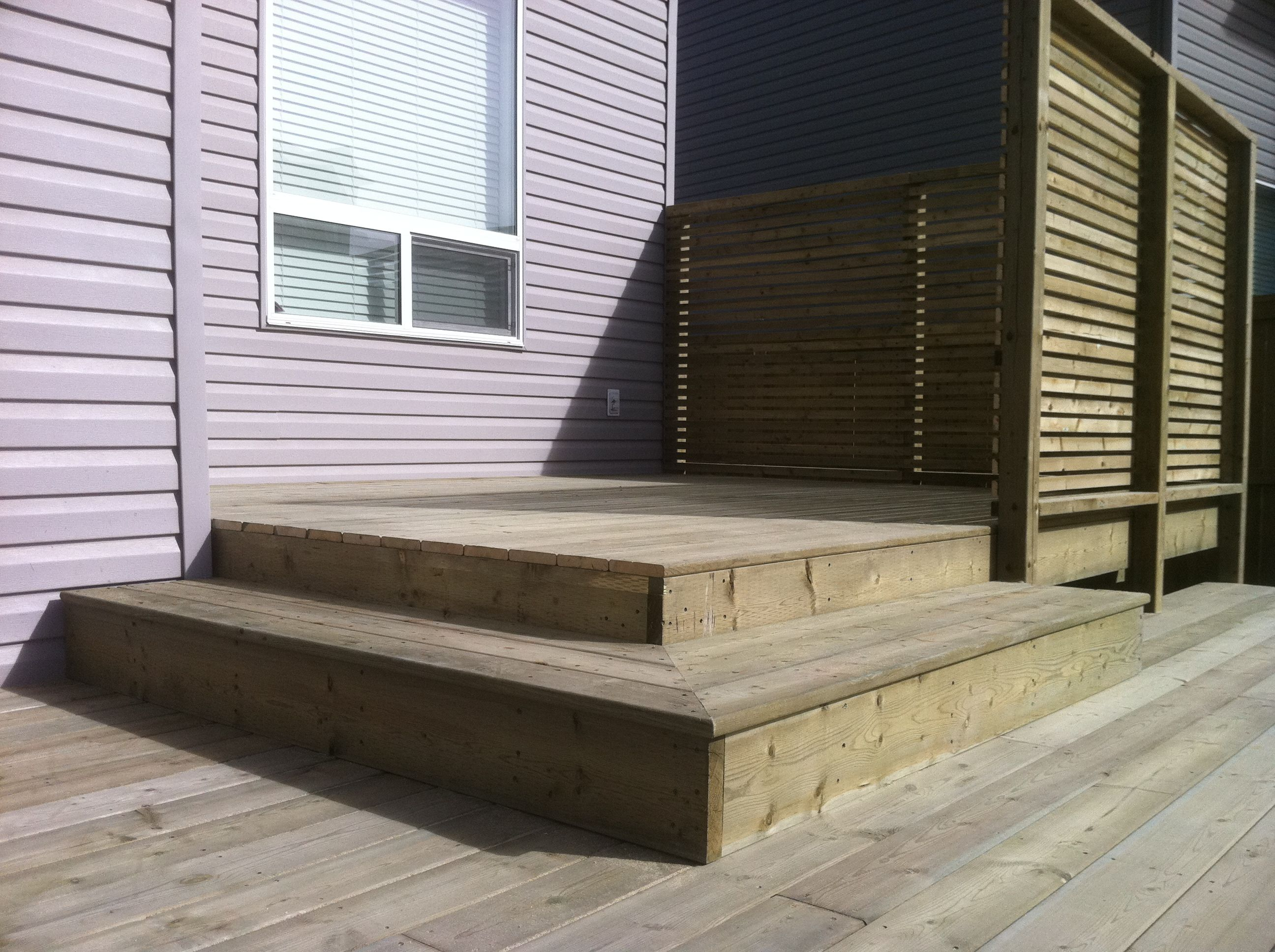 This pressure treated wood deck features a main landing plus a a pressure treated wood deck with a privacy screen partly enclosing the top tier baanklon Image collections