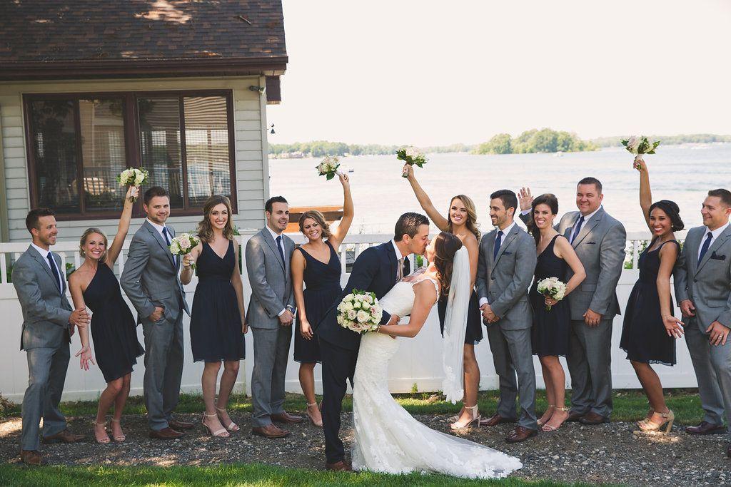 626e8d3b345 Lakeside wedding bridal party photos. Gray tux and navy blue bridesmaid  dresses