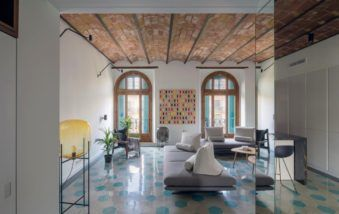 Mirrors Add Playful Charm to Transitional Apartment in Barcelona