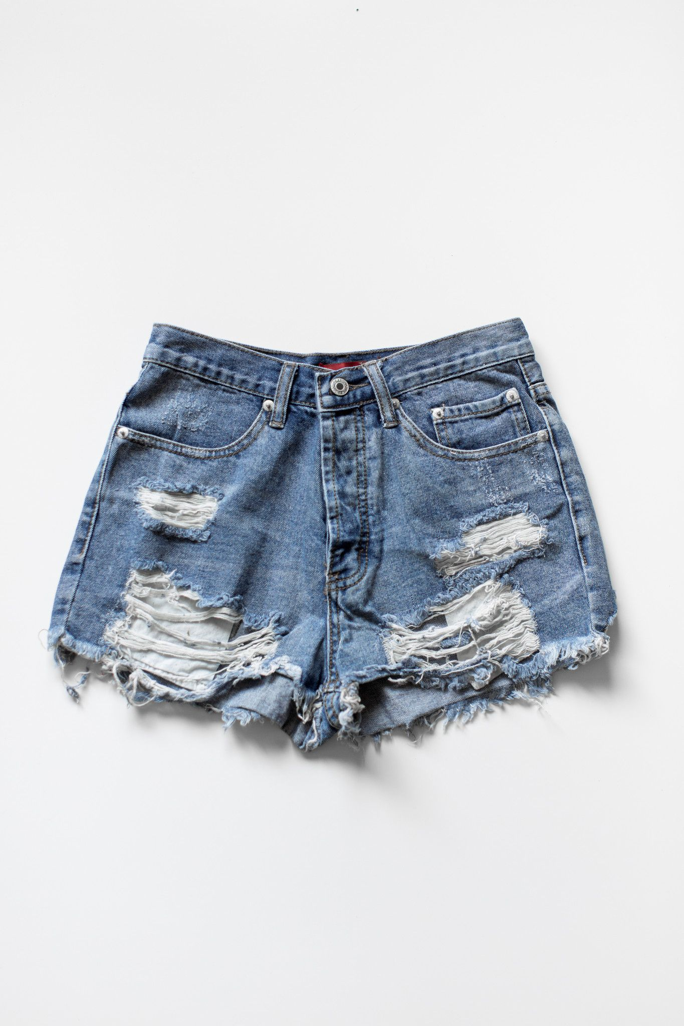 c2bfcbd0306 Vintage inspired high waist denim shorts with frayed and ripped detailing  for a