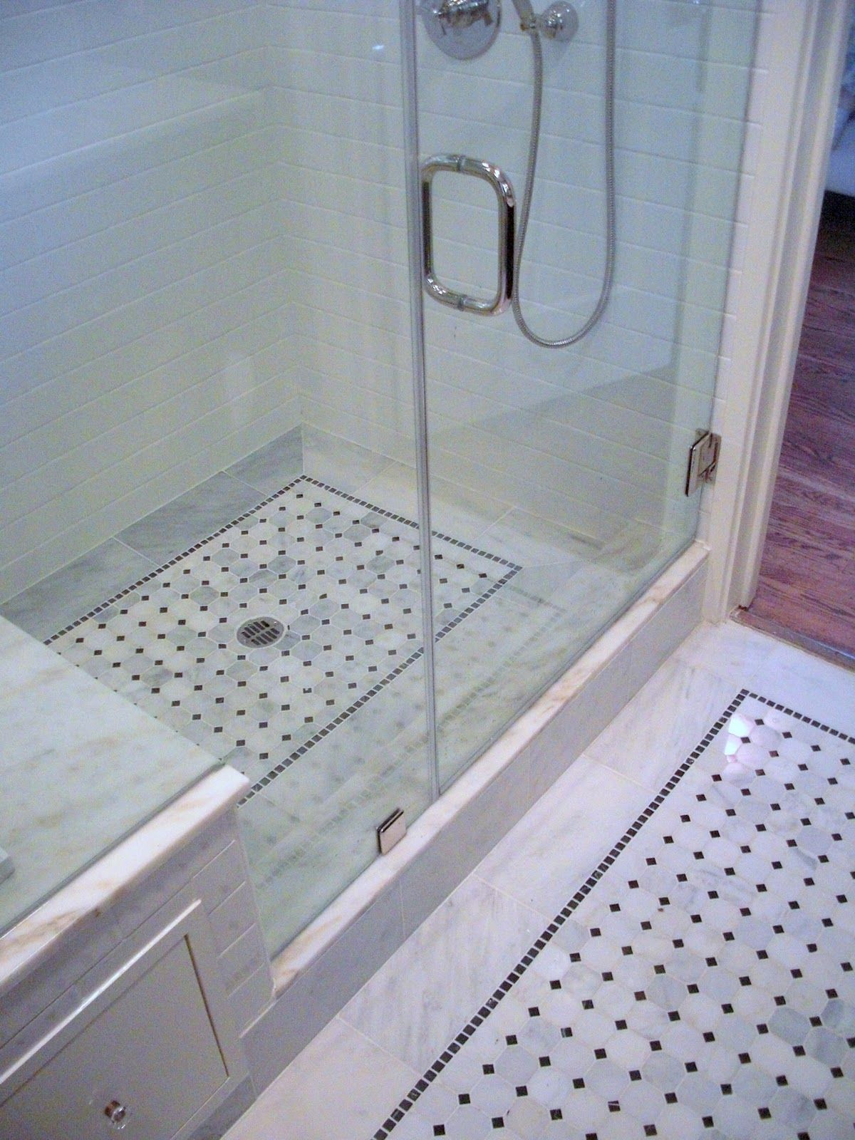 Awesome Walk In Shower. Beautiful Tile Work. Complete With Bench And  Seamless Glass Door