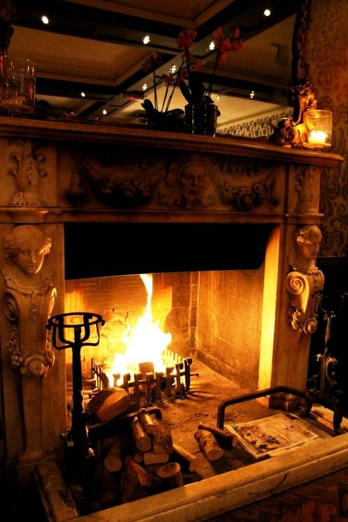 Keeping the fireplace going one cold winter night - What temperature to keep house in winter when gone ...