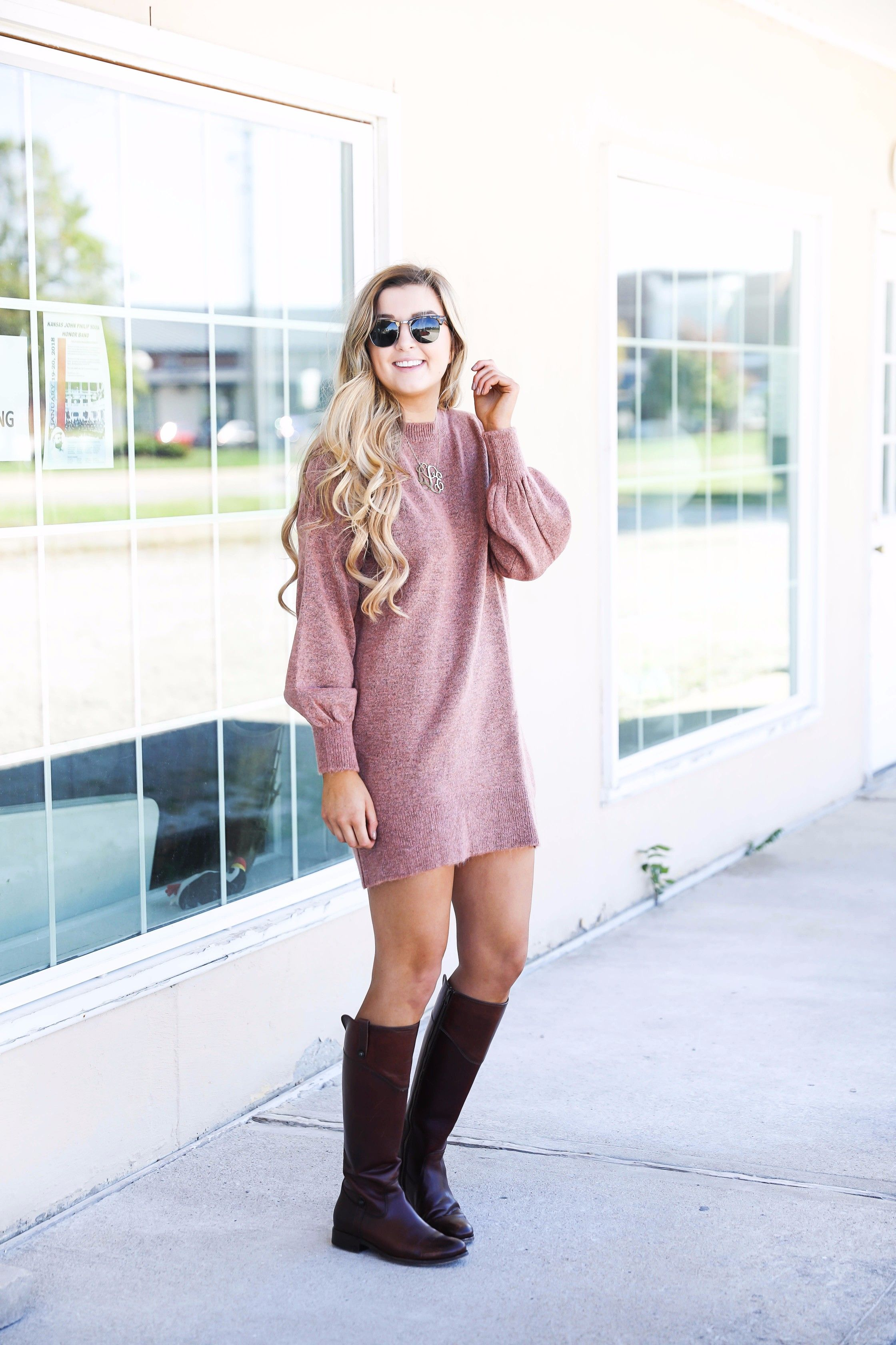 591eb41ee7f4 Sweater dress with puffy sleeves and brown riding boots! Paired with a large  monogram necklace, perfect fall outfit! Details on fashion blog daily dose  of ...