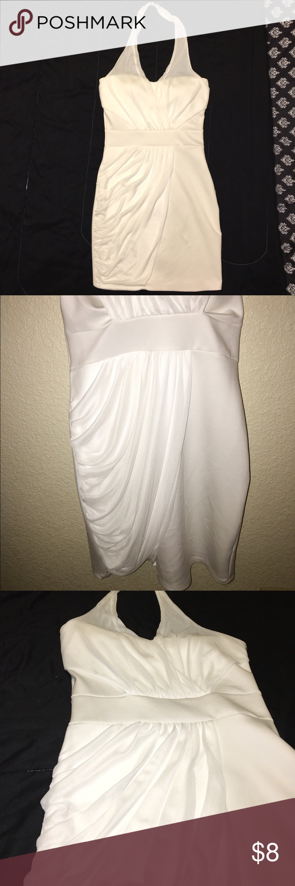 White halter top dress White halter top mini dress. Form fitting dress, sweetheart neckline, halter top straps and mesh draping. Fabric 100% polyester. ‼️PRICE IS FIRM‼️ dulce carola Dresses Mini