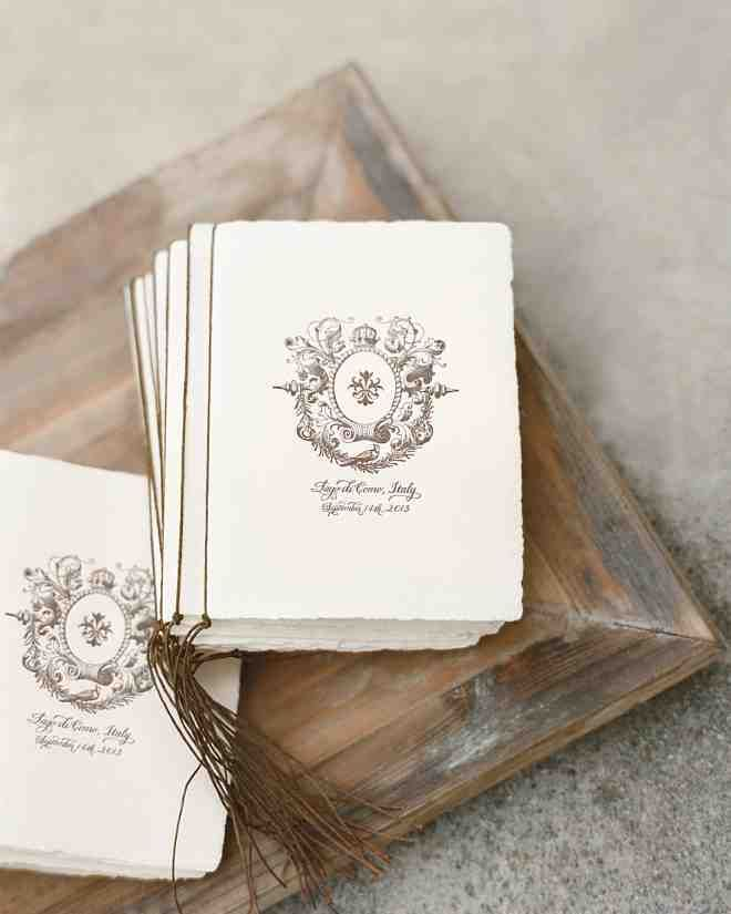 Programs were letterpressed with the crest motif that appeared on the invitations and bound with waxed cord.
