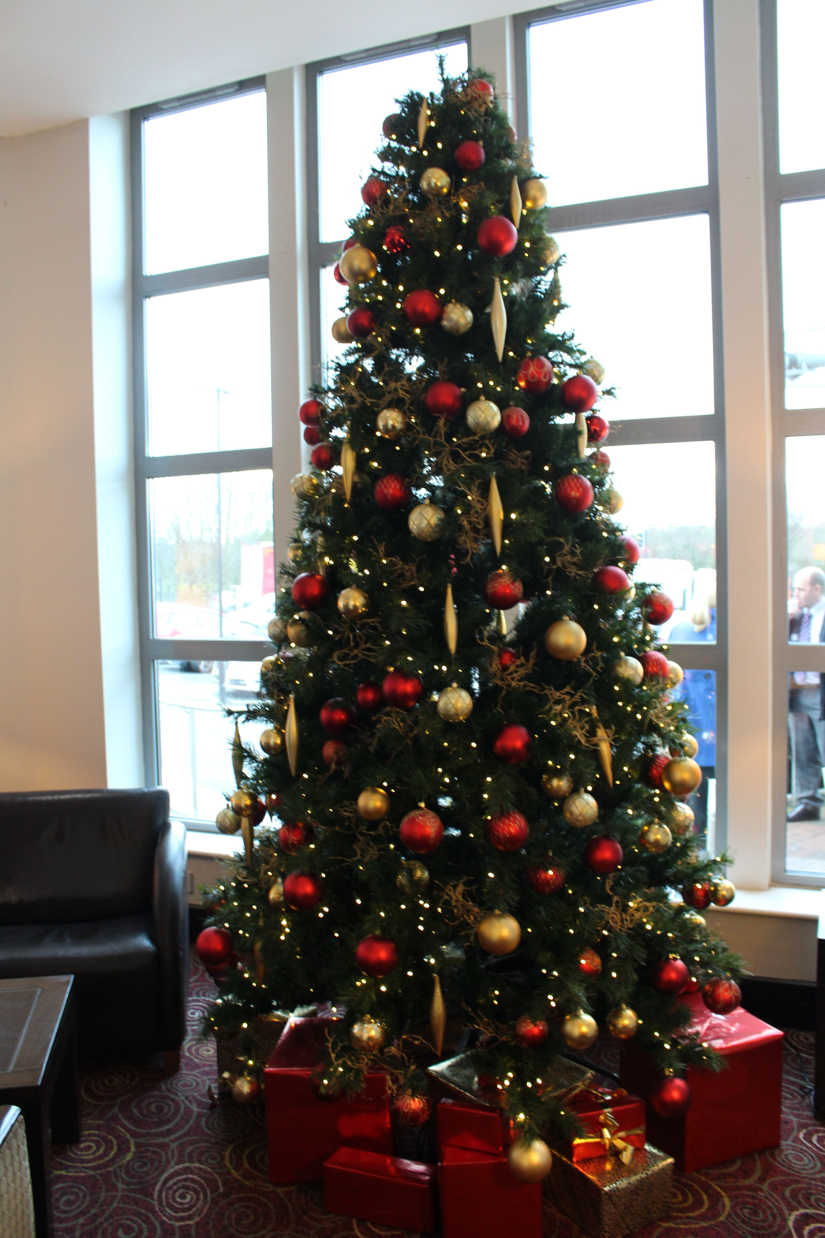 Traditional red and gold Christmas tree with Santa's prezzies underneath! | Commercial christmas ...