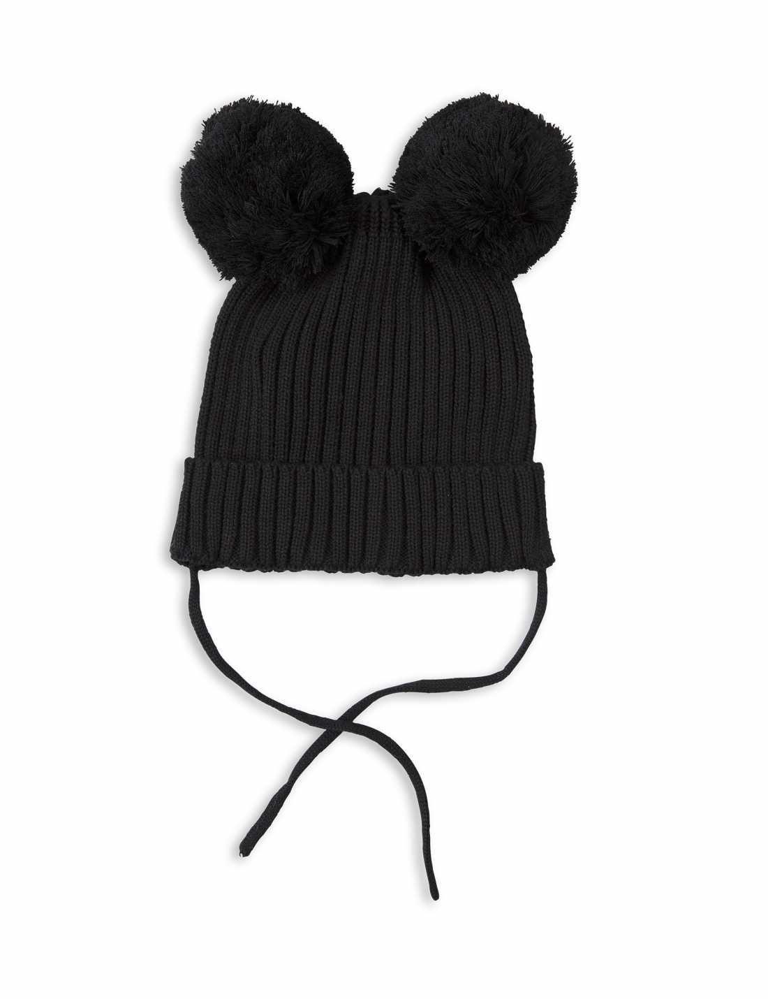 Mini Rodini ribbstickad och varm mössa i svart med garnbollar som öron. Kassisk och återkommande modell från mini rodini som är tillverkad i ekologisk bomull.