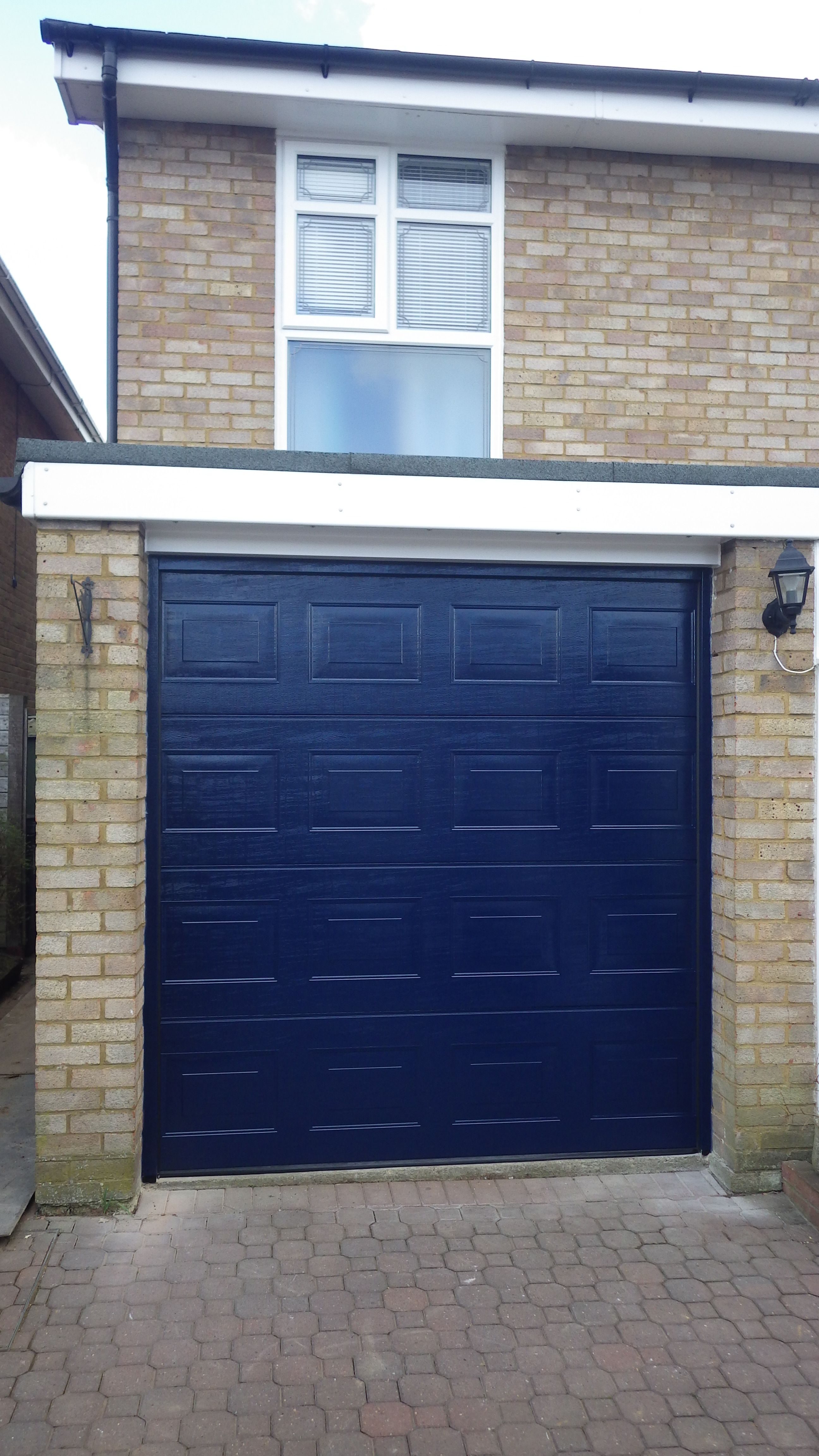 Hormann Sectional S-panelled woodgrain garage door in dark blue. & Hormann Sectional S-panelled woodgrain garage door in dark blue ... pezcame.com