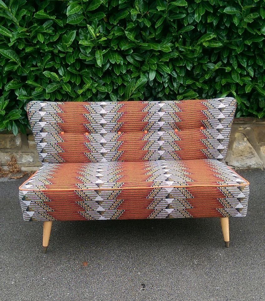 vintage cocktail sofa reupholstered in african wax fabric by