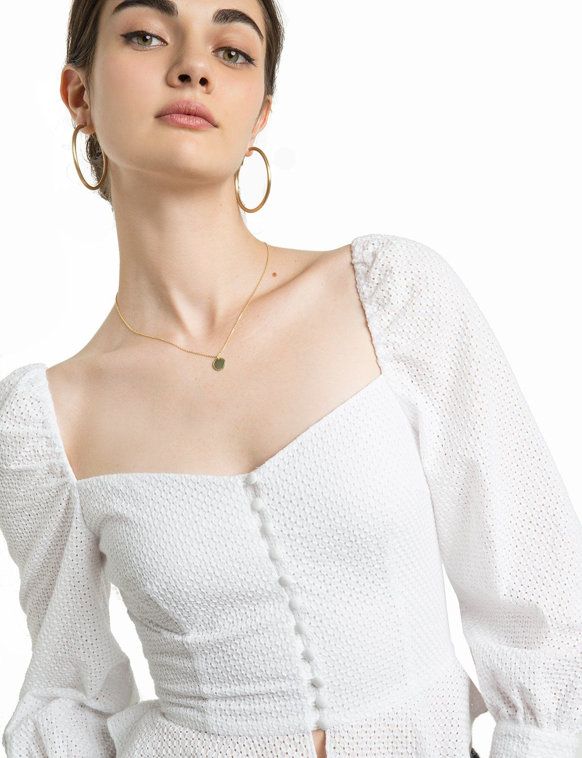 """e16467c04f428f White cotton eyelet puffy sleeve top with corset button down front Made by  us 100% cotton eyelet Length 24.5"""" Model is wearing a size small and  model s ..."""