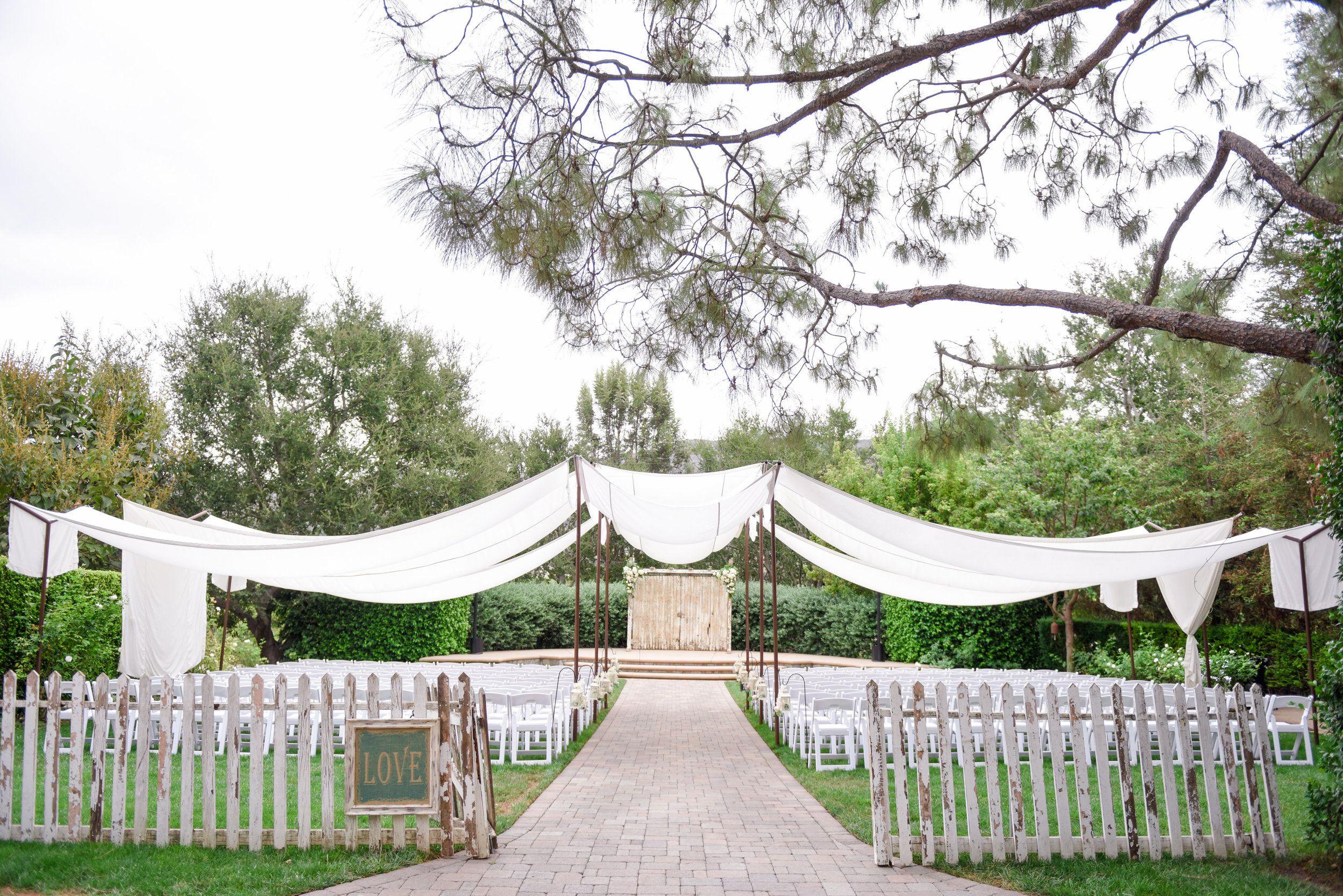 White Garden Picket Fence Wedding Chandelier Wedding Ceremony