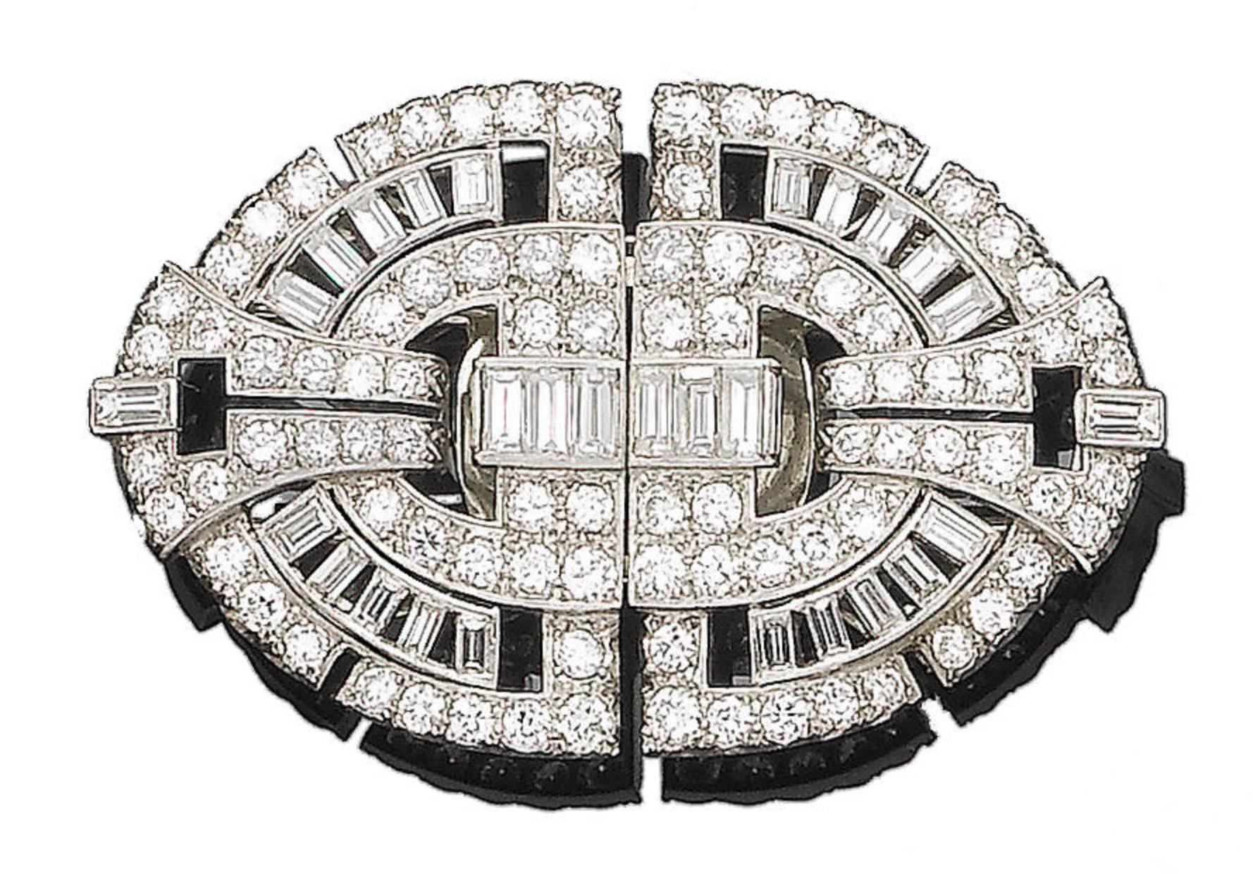 A diamond double-clip brooch Of geometric design, each openwork plaque set with graduated brilliant, old brilliant and baguette-cut diamonds