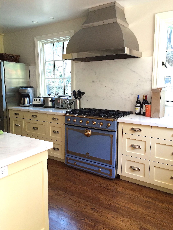 """Kitchen in Palo Alto by Fannie Allen Design Soft yellow """"Shaker"""