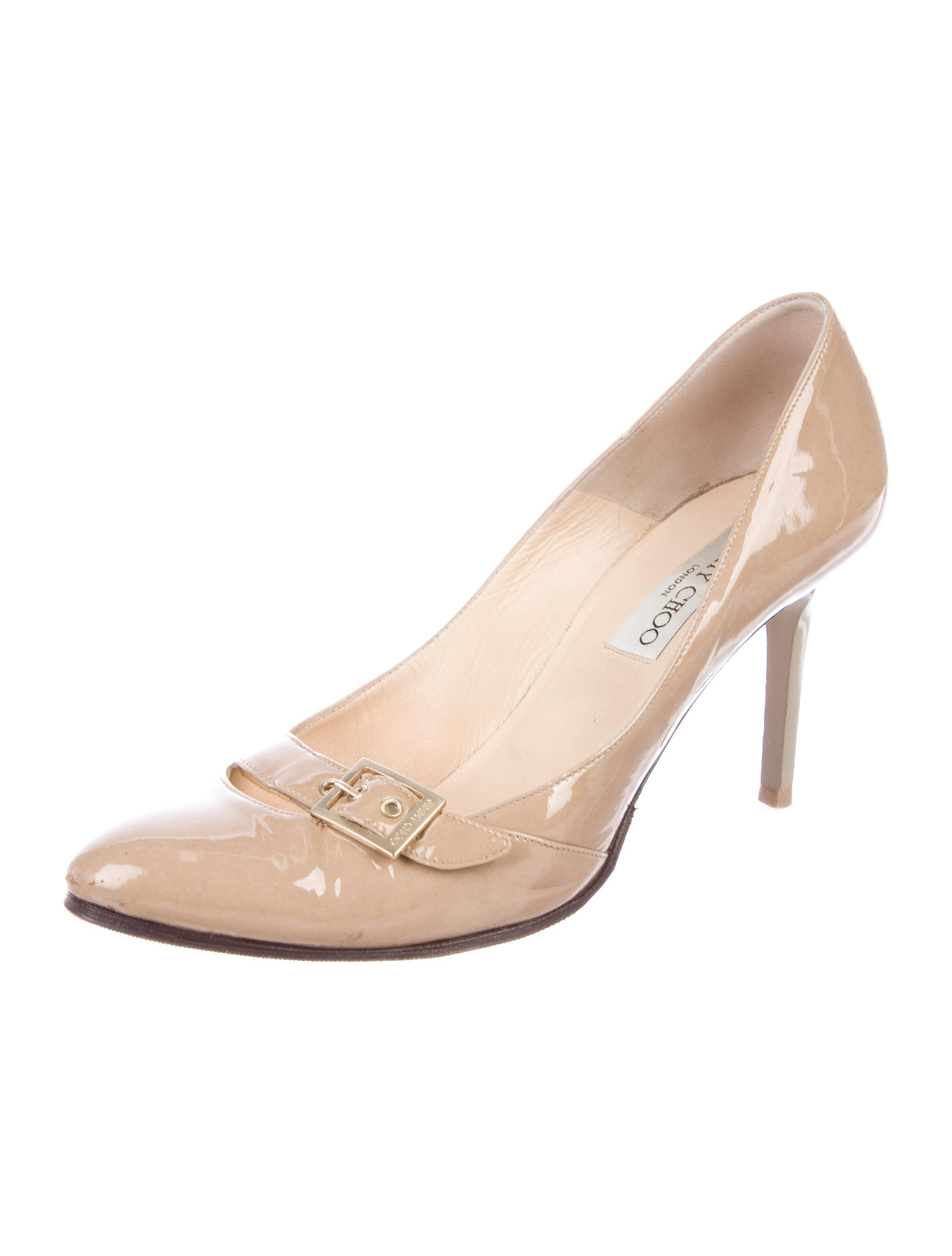 ccccbeee9a3 ... by Womens High Fashion Heels. Tan leather Jimmy Choo semi pointed-toe  pumps with gold-tone buckle accents at
