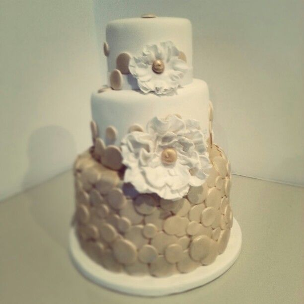 Gold themed fondant cake with two white fondant flowers and several gold themed fondant cake with two white fondant flowers and several gold polka dots 50th mightylinksfo