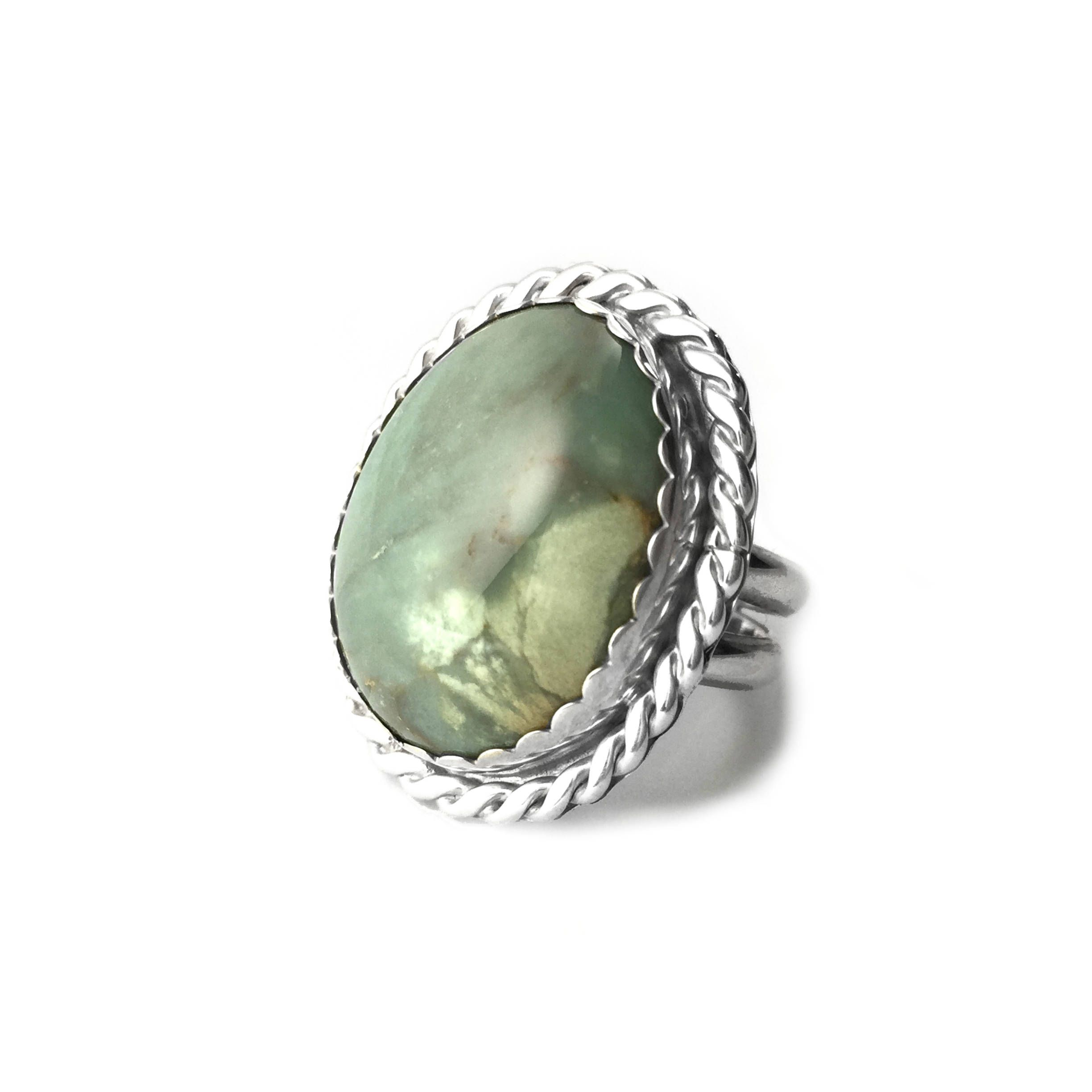uneek in shank stone with green cut gemstone rings ring silhouette and pave three center emerald platinum