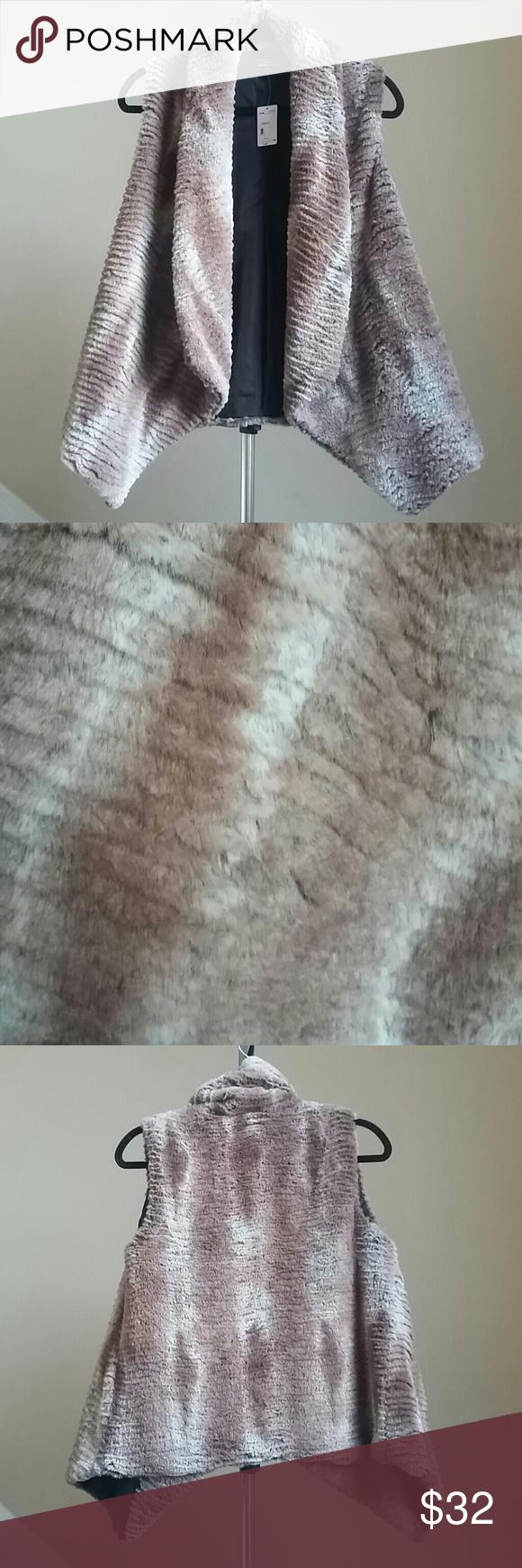 🆕Lisa International Faux Fur Vest Super cute and soft faux fur vest by Lisa International. Lined. Shell and Lining 100% Polyester. 🚨Price Firm!🚨 Lisa International Jackets & Coats Vests